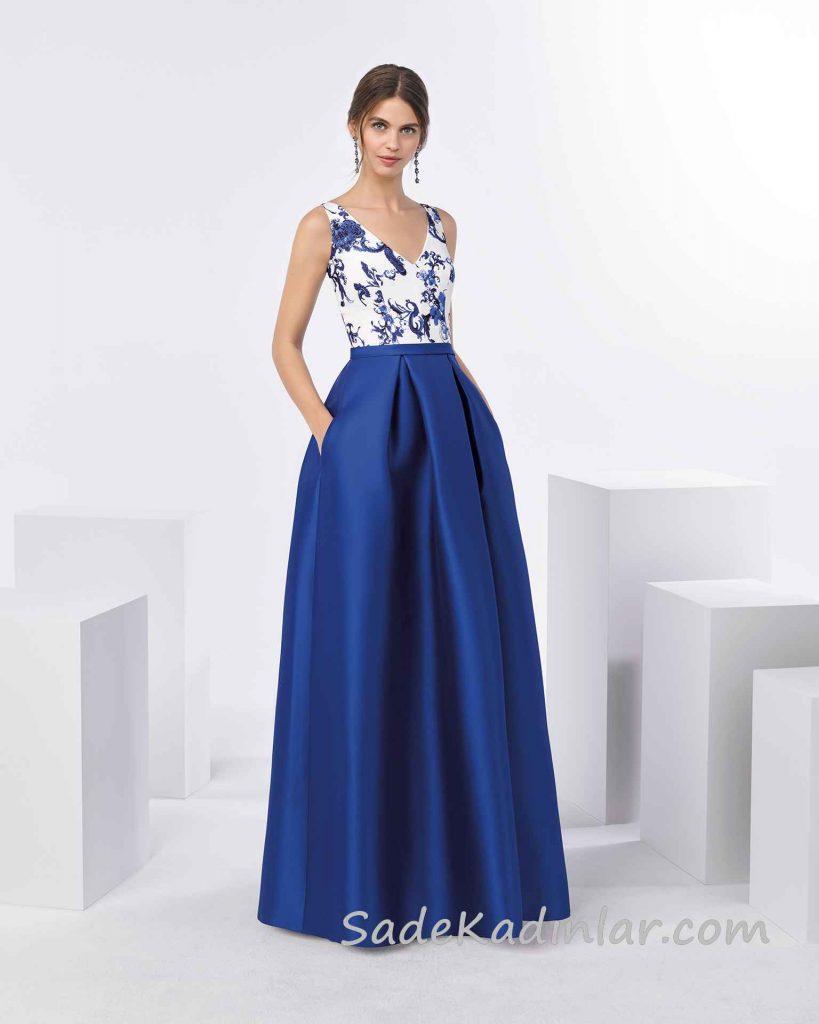 Şık Abiye Modelleri Saks Mavi Uzun Kalın Askılı Desenli