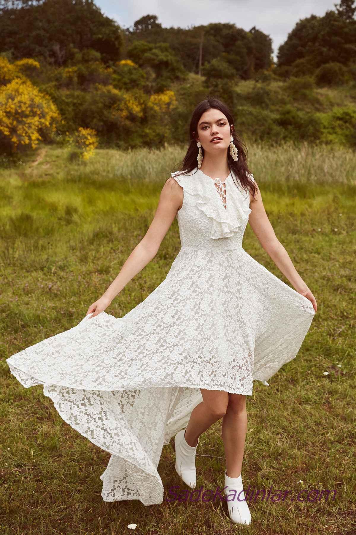 f2741a05e09d4 En Güzel 2019 Beyaz Elbise Modelleri Ön Kısa Arkası Uzun Kolsuz Bağcıklı  Yaka Dantel. «